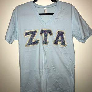 Stitched ZTA paisley letters on sky blue